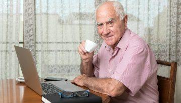 Older man working at PC