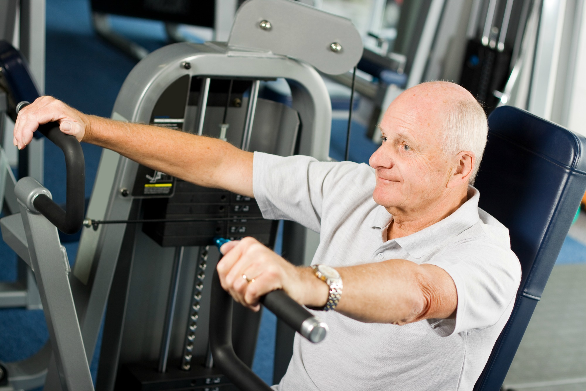 Mature man working out in the gym