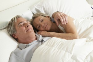 The importance of sleep for good health and well being | Older couple sleeping -Dollar Photo Club