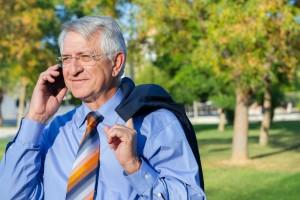 Older businessman with mobile 600kb Dollarphotoclub