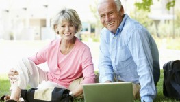 Older couple using laptop in parkDollarphotoclub_550kb