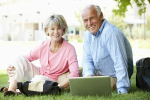 Make extra money for retirement-Mature couple using laptop to access their online business