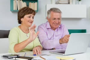 Older Couple working Internet Marketing Business from home