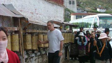 Ringing The Bells at Entrance to Potala Palace Lhasa, Tibet